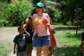 Lisa holds a handful of flowers in Santa Rosa, Peru, on WordServe's very first Compassion Trip.